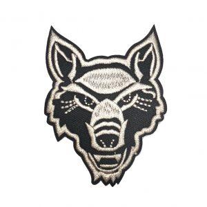 Beige Bügelfleck eines Wolfskopfes